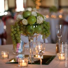 Love this centerpiece. Replace the apples with pinecones and keep the white roses. WINTER WEDDING <3