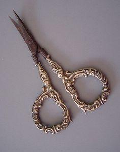 Antique sewing scissors  http://thoroughlymodernmormon.files.wordpress.com/2011/04/sciss5428-e1303317667474.jpg