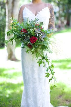 Bridal bouquet with Emu feather and Sea star fern