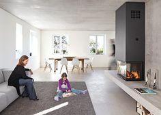 Kamin mit Sitzbank - gute Idee, allerdings mit wärmeren Farben / Steinen umsetzen