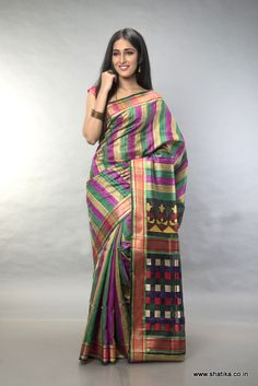 The beguiling stripes in a combination of pink, green and dull gold is the culmination of the very enchanting Kishorini Tri Color Striped Matka Silk Saree. This combined with the engaging checks pattern on the pallu in bold colors is the icing on the cake.