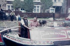 """BW197-2-23-4-1 a boat Rally on the Leeds and Liverpool Canal including a barge loaded with rubbish, the Skinners horseboat """"Friendship"""" with the Skinners and their dog on board, the motorboats """"Trent"""" and """"Tay"""" and many small cruisers Date 1968"""