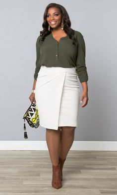 Break out of the typical black pencil skirt option for work and opt for a chic choice like our plus size Uptown Faux Wrap Skirt in white. Add a classy blouse, sharp heels and fun clutch to complete your corner office style. See more work-ready attire at www.kiyonna.com. #KiyonnaPlusYou #MadeintheUSA