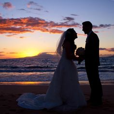 The newlyweds take a moment to enjoy the sunset