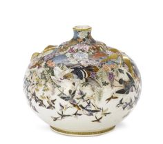 A small Satsuma vase By Kinkozan, Meiji Period Of squat, globular form with a short neck, finely decorated in enamels and gilt with a flock of assorted migrating birds including pigeon, sparrows, thrush and kingfishers, in flight amidst seasonal blooms including hydrangea, peony, chrysanthemums and trailing wisteria, the shoulder applied with two gilt sprigs of foliage rendered in relief, signed with gilt seal Kinkozan and impressed seal Kinkozan.