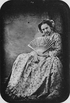 1843, lady with fan, great dress and hair ornaments......
