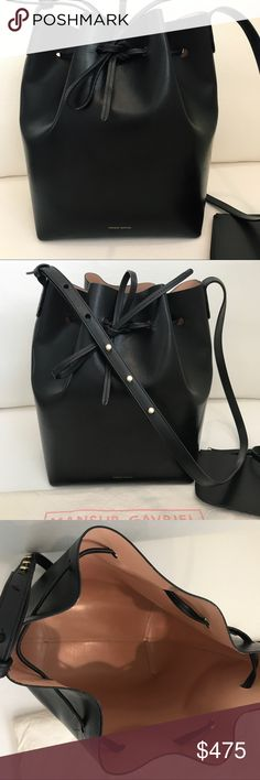 Authentic Mansur Gavriel Bucket Bag - Ballerina Beautiful Mansur Gavriel Large Bucket Bag.  Black exterior, Ballerina Interior (a nude pink). In excellent condition. Scuffs shown in photos.  Not noticeable head on.  I am only selling this bag because I no longer wear leather. My loss is your gain! I also have the original email receipt.  This was one of my favorites- reasonable offers only please.  Interior in perfect condition as shown in photos.  Wear it with absolutely everything. Mansur…