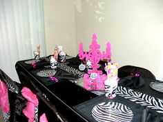 At Home Spa Party Ideas | The Party Table includes: black table cloth, zebra table runner, zebra ...