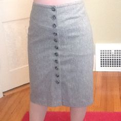 Grey Banana Republic pencil skirt Beautiful grey wool pencil skirt, lined, with button detailing up the front. Perfect for any closet! Banana Republic Skirts Pencil