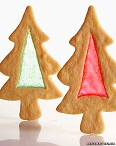 Stained Glass Christmas Tree Cookies ~ To make your own cookie shapes, draw a simple Christmas-tree or ornament shape onto a manila folder, and cut it out. Place the cutout on rolled-out cookie dough, and cut around it with the tip of a paring knife. Alternatively, you can cut out cookies with cookie cutters (wide shapes work best). Use the knife tip to cut out the centers of the cookies.