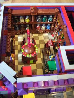 Interior of the Candy Shop  This is the beautiful Lego Muntstraat of Jasper Joppe Geers on display in the Thermen Museum in Heerlen, Netherl...