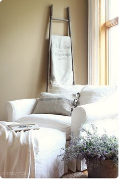 reading corner... looks so comfy... Need to make this happen in my sun room =)