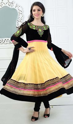 Elegance and fire is the order of the day when choosing this black and yellow georgette Anarkali churidar dress. Beautified with butta, lace, patch and resham work. #LatestJewelNeckAnarkaliSuit