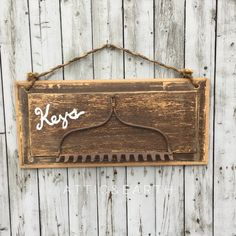 This rustic key holder was made using recycled materials and will add charm to your space. The key holder is wide by tall (not including the heig
