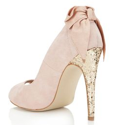 pink shoes with gold glitter heels and bow