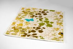 Modern Cat Mat in green, yellow and brown botanical pattern with turquoise butterfly