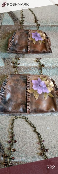 Liz Soto Brown Handbag with Flowers You are purchasing a Liz Soto handbag with chain.  This purse is gorgeous with the decorative chain strap.  The front of the purse has two flowers on it.  There's a clasp entry to go inside the purse.  The flowers are lavender and beige. I wish I code keep, but need to clean the closets. Liz Soto Bags Shoulder Bags