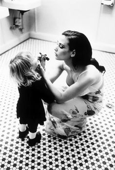 Demi Moore and her daughter.  Passing it down. Black and white - duality