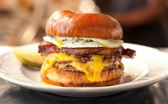 "Americans eat 50 billion burgers (cheese and otherwise) a year! Celebrate National Cheeseburger Day (September 18) with these other juicy facts.—Food Network dubs the cheeseburger at Au Cheval in Chicago (pictured above) the No. 1 burger in the country. It features three beef patties with a ""perfect burger-to-cheese ratio.""—Who invented the cheeseburger? Nobody knows for [...]"