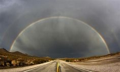A double rainbow appears after a heavy monsoon storms over Nipton Road in Searchlight, Nevada, July 13, 2012.   REUTERS-Gene Blevins