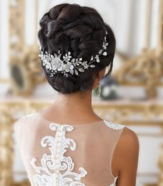 ⠀ ✽ This feminine CHRYSANTHE jewelry item is an extravagant sweet-looking model. It's a fabulous product for classic-looking brides with Cinderella gowns, fairy-tale like makeup and romantic loose updos. ⠀ ✽ Three charming white faux pearl flowers are the center of the pattern. Little branches bedecked with leaves and small crystals. ⠀ ✽ The price is $64.99 ⠀ ⠀ ⠀ #topgraciawedding #bridalhair #bridalhairflowers #weddingheadpiece #bridalheadpiece #rhinestoneheadpiece #promheadpiece…