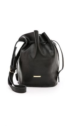 Gorgeous classic drawstring bucket bag. Pebbled leather is a nice touch.