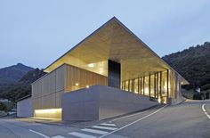 This multi leveled winery sits in the hillside comprised of porphyry walls which blend with it's context.