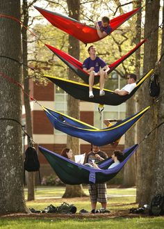 "East Carolina University students (from top to bottom) Matthew Archibald, Matt Schurtz, Thomas Briley, Chris Dowd, Danielle Spence (left in bottom hammock), Matt Ghezzo and, standing, Ryan Williford, ""hang out"" in the quad on Monday April 11, 2011. The group hung their hammocks between trees to enjoy the warm Spring weather and because it was a ""relaxing alternative to studying in the library, "" Spence said. Photo: John Hansen - The News & Observer"