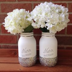 Glitter Mason jar, wedding mason jar, winter wedding, winter decor, silver glitter, spring mason jar, spring wedding, white wedding decor by shopcampcreate on Etsy https://www.etsy.com/listing/255007089/glitter-mason-jar-wedding-mason-jar