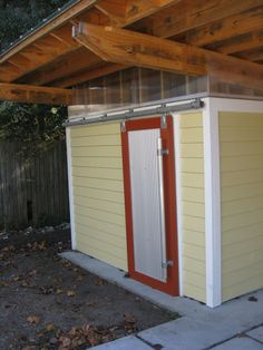 Shed Door, using barn track, corrugated metal and pipe & clamp.
