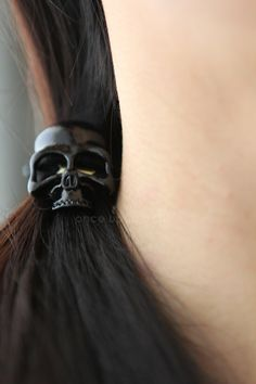 Creepy and stylish at the same time:) PERFECT for a unique look! Just in time for that awesome pony tail!  Also available in antique gold :) Please choose from drop down menu...  Skull measures approximately 3x2.5 cm ***Long hair can get twisted in elastic tie so please be careful!  For more cool hair ties... https://www.etsy.com/ca/shop/onceuponaCHO?section_id=15355693&ref=shopsection_leftnav_5  Enjoy