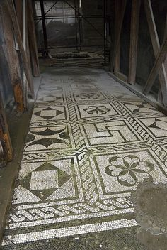 Herculaneum, Italy noble house hastonish mosaic floor and beautiful painting on the wall