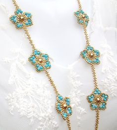 Necklace Beaded Turquoise Swarovski Crystals Pearls Gold Beads Statement Handbeaded Necklace 'Daisy Chain' - Care - Skin care , beauty ideas and skin care tips Beaded Jewelry Designs, Bead Jewellery, Bead Earrings, Handmade Jewelry, Beaded Necklace, Beaded Bracelets, Pearl Necklace, Turquoise Necklace, Chandelier Earrings