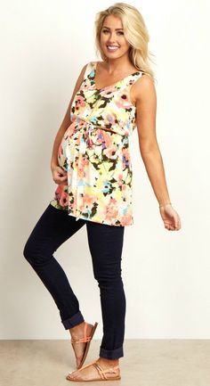 This maternity top will add that gorgeous splash of color your wardrobe needs. A v-neckline and sash tie detail with a floral print will beautifully show off your bump this year. A pretty draped back is what really sets this maternity top apart from the rest. Style this maternity top with maternity jeans and boots for a complete look.