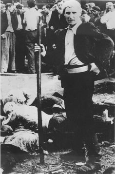 Kovno, Lithuania, A young Lithuanian by the bodies of his Jewish victims, 24/06/1941.