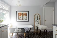 Both the marble side table and the Art Deco light fixture are vintage finds from Etsy. Best of all, the house actually dates to the origin of the Art Deco period!