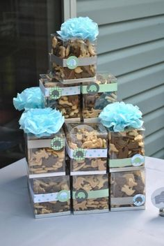 There are frosted jungle cookies too.  Animal cracker favors for elephant theme... Plus some other ideas.