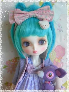 A very pretty BJD with turquoise hair.( I know I know I had to sneak this one in here)