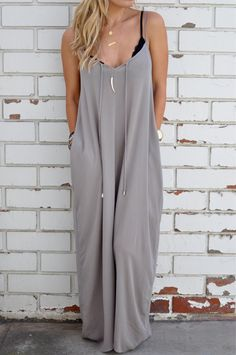 "An effortless maxi dress featuring a billowy silhouette, side pockets, and a keyhole detail with ties (un-tied in picture). Adjustable spaghetti straps. Unlined.  100% Rayon Gauze 55"" length 