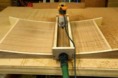 "How do you make a perfectly fair curved surface out of solid wood that's 20"" wide , 28"" long, and almost 3"" thick? That was the challenge o..."