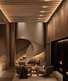 The lobby of the New York Edition hotel features helical steel stair, paneled with light oak.