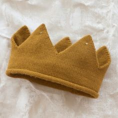 felt crown? Kids would have a great time decorating with felt, flannel, or Velcro attached gems!