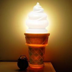 A giant ice cream cone lamp for anyone who ~lights up~ at the thought of ice cream.