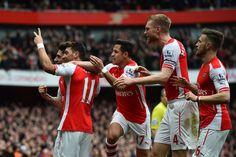 Mesut Ozil celebrates with team mates after scoring