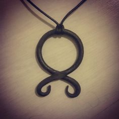 forged troll cross necklace