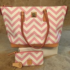 Hand bag Pink and White, Chevron Print Dooney & Bourke handbag made of Coated Cotton with tan leather straps and feet on the bottom.  Also includes a Chevron Print coin purse and  leather key ring. Dooney & Bourke Bags Shoulder Bags