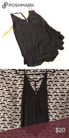 Free people dark grey wrap and tie tank M Super soft. Flowy and breezy. Later it or wear it alone, dress it up or wear with your favorite cutoffs. This is a great top! Size is medium and sadly too large for me now. Fits in a draping fashion so it is not a very small medium. Free People Tops