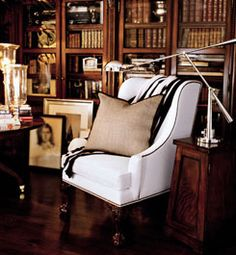 I love the white chair to lighten up the dark space. Ralph Lauren.