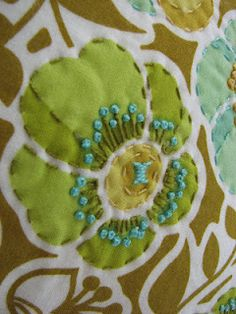 Use a large floral print fabric and then embellish with embroidery....brilliant!