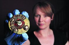 """""""A Saxon brooch found in West Hanney. Found in the grave of a 25 year old woman. The brooch is a rare type dating from the 7th Century and is decorated with garnet and gold inlays."""""""
